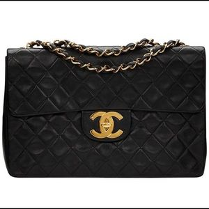Rare find Chanel Quilted Double Flap Black 18k